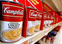 Cans of Campbell's Soup on a store shelf.