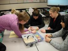 Children and Families students working with math manipulatives.