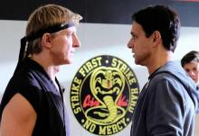 "William Zabka as Johnny Lawrence faces off against Ralph Macchio as Daniel LaRusso in ""Cobra Kai"""