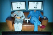 Photo of two people with television heads
