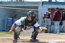 Dan Cameron the catcher for the Hawks baseball team in the field