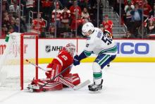 Detroit Red Wings Goaltender Jimmy Howard makes a save against Vancouver Canucks Center Bo Hovart during a shootout at Little Caesars Arena