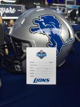 Detroit Lions helmet with blank draft card in front of it.