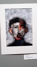 Photo of Picasso style collage of African American face with other faces folded in.