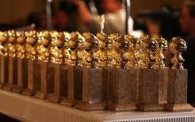 Photo of several Golden Globe statuettes lined up.