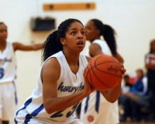 Photo of a woman playing basketball.