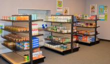 Photo shows the interior of the Hawks' Nest food pantry with shelves of food