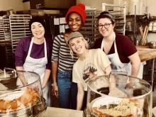 Bri Meilbeck (white t-shirt) and co-workers at Sister Pie bakery.