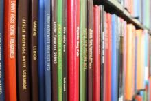 Close up photo of books on shelves.