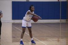 Basketball player Mariah Mitchell of Henry Ford College calling out a play