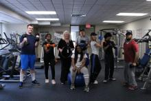 Image of fitness class posing with dumbbells
