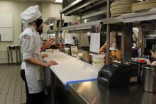 Student chefs in Fifty-One O One kitchen this month photo by Muna Saleh