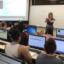 Jennifer steward asl instructor teaching in a class