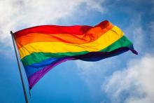 LGBTQ flag waving in breeze