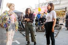 """Image shows Margot Robbie, Rosie Perez and Cathy Yan on the set of """"Birds of Prey"""""""