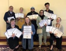 Mirror Newspaper staff holding up awards at 2019 Michigan Community College Press Association conference at Central Michigan University, April 6, 2019