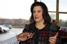 Photo of Gretchen Whitmer answering questions from the press