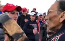 Nathan Phillips in Native American apparel and crowd of students wearing Make America Great Again hats and sweatshirts at Washington D.C. mall, Jan. 18, 2019