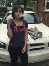 Dina Alzumut using an e-cigarette