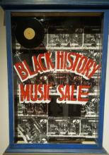 Jerry White's Record Shop's window written on it  the Black History Music Sale