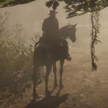 Gameplay screen capture of Red Dead Redemption 2 showing a man riding a horse