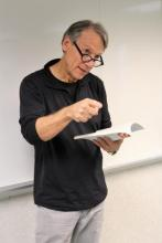 Photo of author Rick Bailey reading from his book Italian Chocolate American English