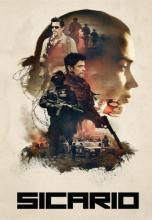 Movie poster for Sicario. The main characters are depicted wearing body armor and holding guns. Kate Macer's profile is cast in the background in a silhouette.