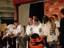 Several Tiger players sit on stage