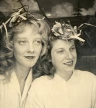 Photograph of two women with straw hats, around 1950-1960. Photographer unknown.
