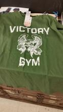 Army green t-shirt with Victory Gym written in white block letters.