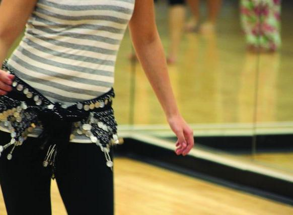 Photo of midsection of woman wearing gym clothes in a gym swaying hip. Photo courtesy of Boise State University Campus News.