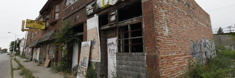 Abandoned business and blighted building on street in Detroit.
