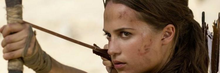 "Alicia Vikander as Lara Croft in ""Tomb-Raider"" holding a bow and arrow"