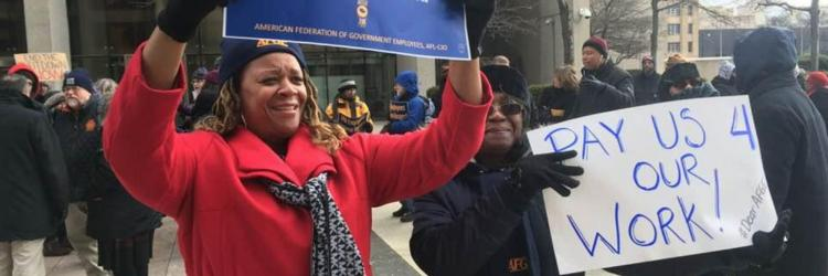 Federal workers and their supporters protest the ongoing partial government shutdown in Detroit. Jan. 10, 2019