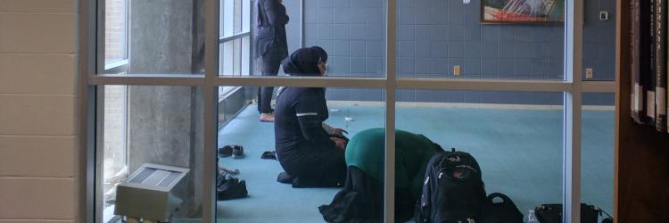 Students take a moment out of their day to meditate.