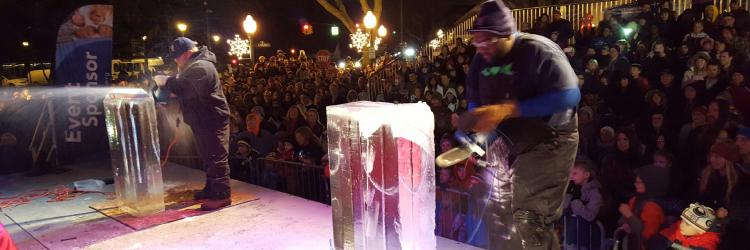 Steve Mccormick and Robert Speeks in dueling chainsaws competition at Plymouth Ice Festival