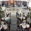 Overhanging shot of white linen tables with guests seated in formal wear at Henry Ford College President's Gala