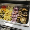 Grilled vegetables inside stainless steel warmer