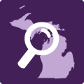 Michigan with magnifying glass over it.