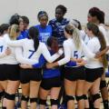 Group huddle of Hawks girls volleyball team