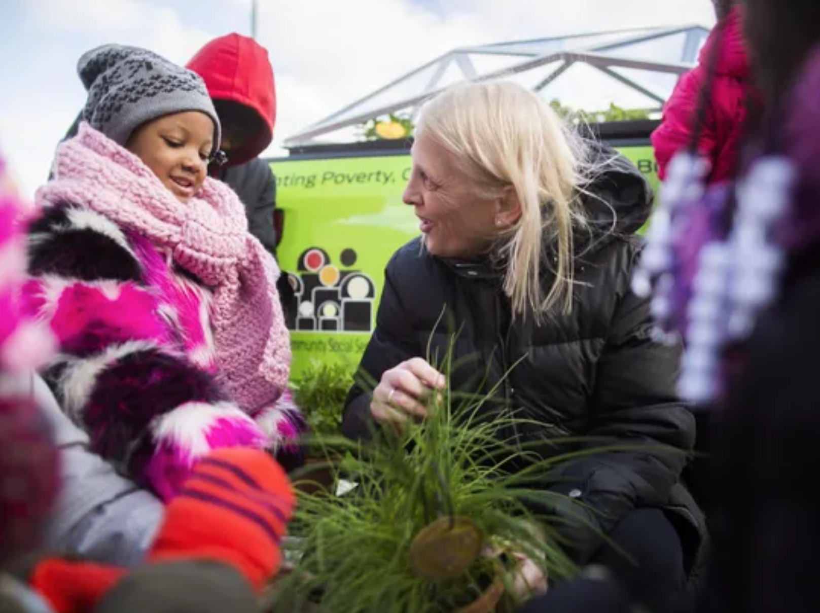 Rev. Faith Fowler, executive director of Cass Community Social Services, speaking with a student in the Ford Mobile Farm