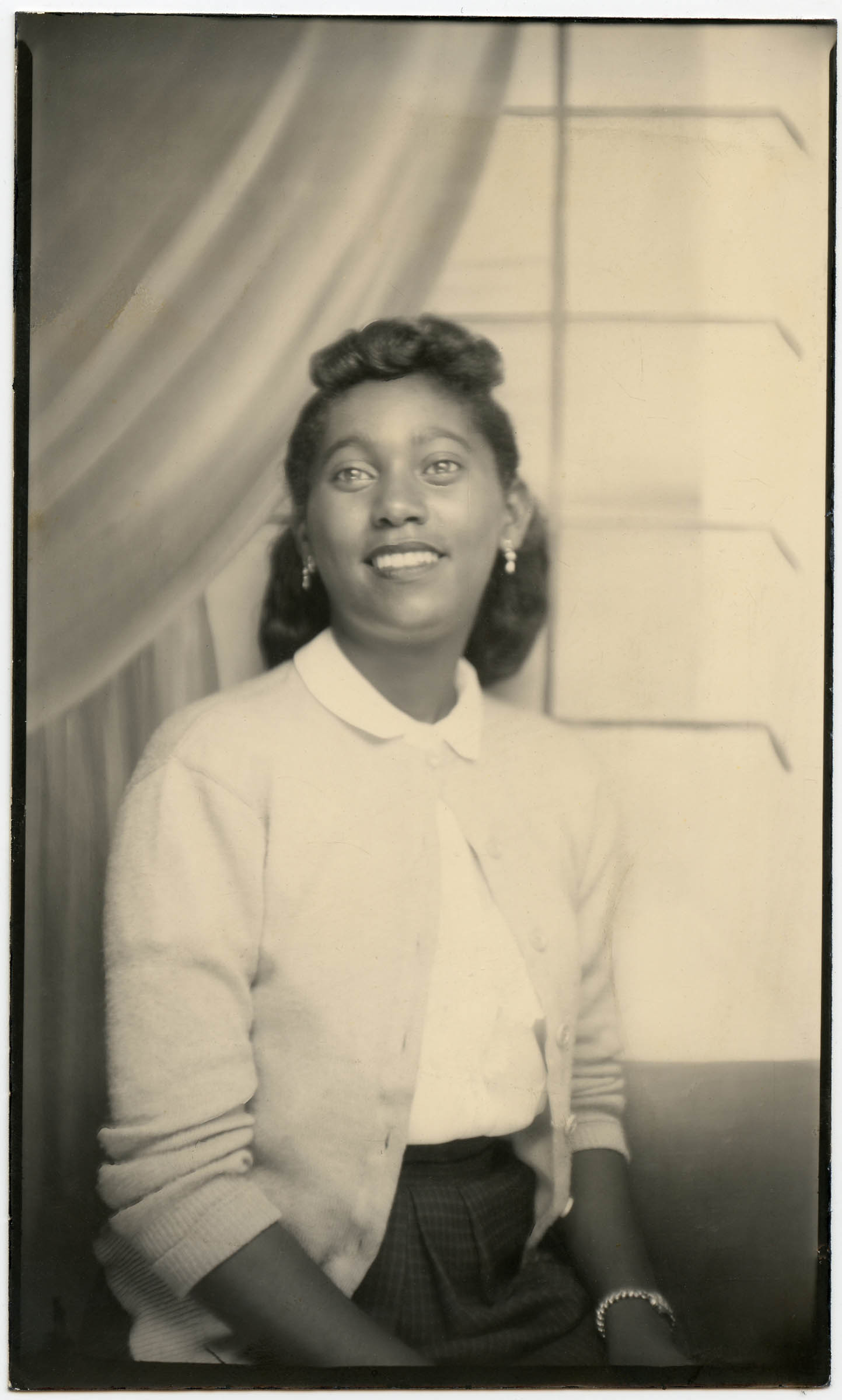 Portrait of a woman in a white sweater, around 1940-1950. Photographer unknown. Courtesy DIA.